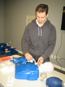 Applying AED pads during CPR training